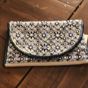 Embroidered clutch with chain.